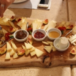 The cheese platter with fig jam, honey and fruit